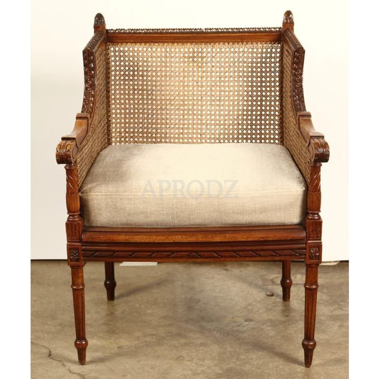 french cushioned brown cane armchair